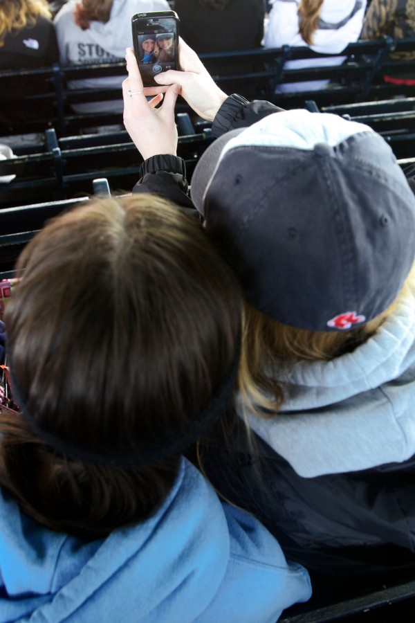 Sisters Lindsey (left) and Kaitlyn Hall take a picture of themselves at Fenway Park in Boston Saturday while on a reward trip after serving with Volunteers of America Northern New England.