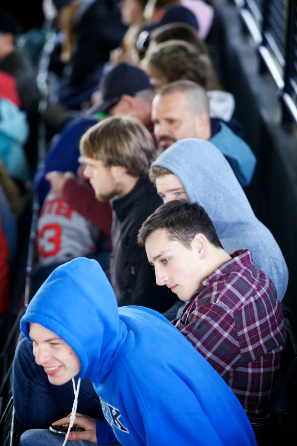 York High School students Dan Galante (from front) Chris Timmons, Brandon Watkins and Theo Bullock watch the game at Fenway Park Saturday as a reward for service with Volunteers of America Northern New England.