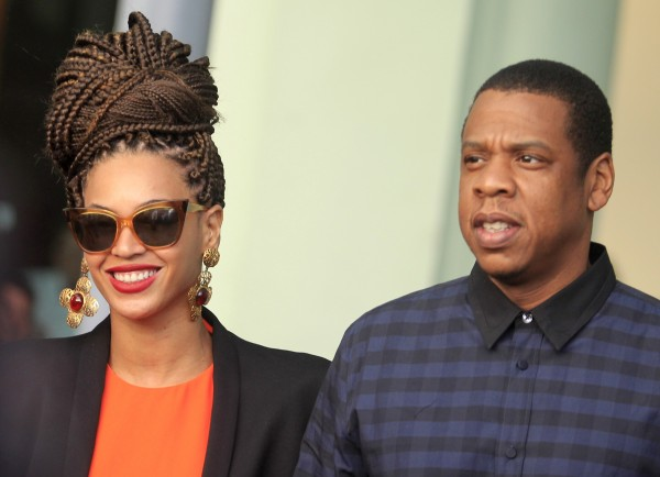 Singer Beyonce (L) and her husband, rapper Jay-Z, leave their hotel in Havana on Thursday.