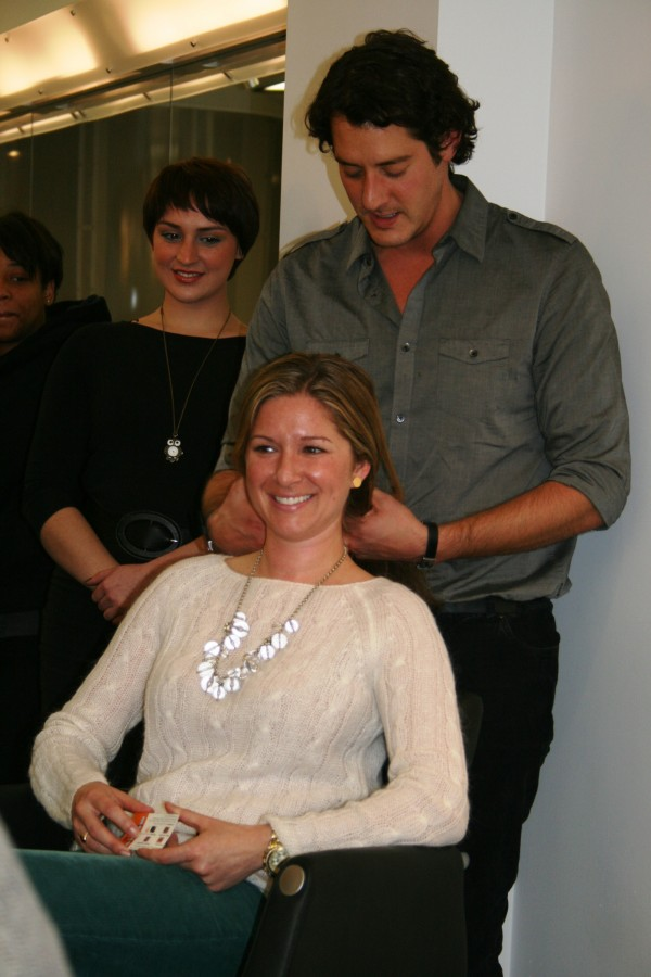Stylist Tyler Trifilo of Salon Mario Russo on Boston's Newbury Street practices &quotThe Skinny On Skin&quot technique at a recent training session