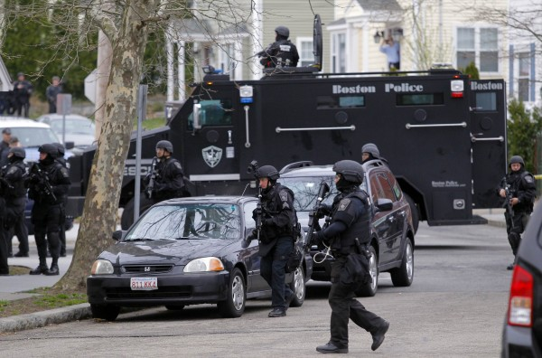 SWAT teams enter a suburban neighborhood searching for the remaining suspect in the Boston Marathon bombings in Watertown, Mass.