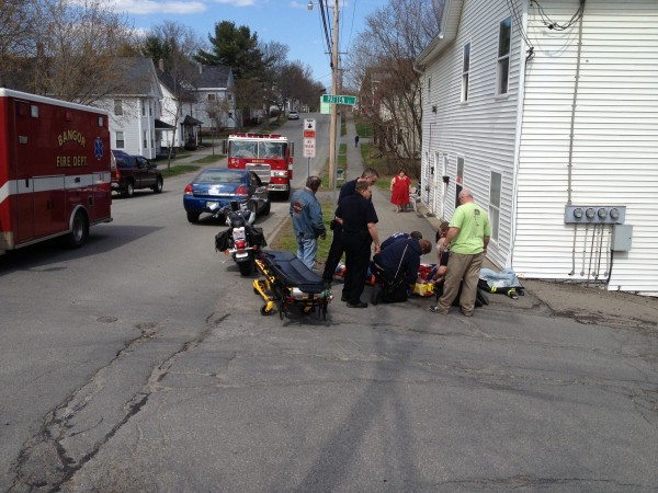 Rescue personnel tend to Theresa Snyder of Bangor after she was injured in a motorcycle accident on Sunday afternoon.