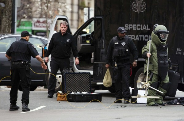 Law enforcement bomb technician prepares controlled detonation of suspicious object during search for a suspect in Boston Marathon bombing, in Watertown, Mass.