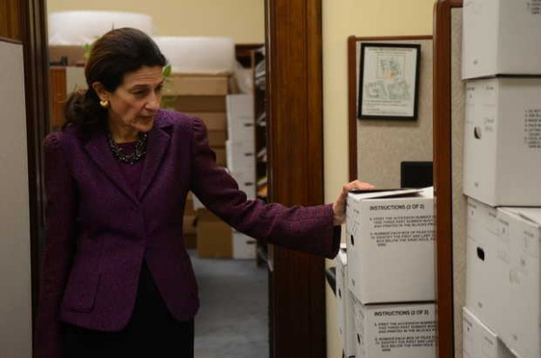 U.S. Sen. Olympia Snowe, R-Maine, looks over the boxes of files packed for storage and moving in her offices in Washington, D.C. ,after she gave her farewell address to the Senate and the nation in December 2012.