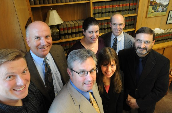 Lawyers with the Volunteer Lawyers' Project plan weekly clinics in bangor. Members of the project are (from left) John Canders, Brett Baber, Christopher Largay, Sarah Newell, April Bentley, David Casavant and Jim Mitchell.