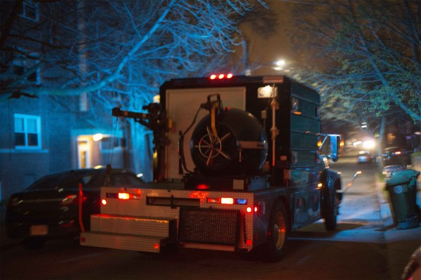 A law enforcement vehicle carries a bomb disposal device through Watertown during a search for the two men suspected of setting off two explosions during the Boston Marathon in Watertown, Mass.