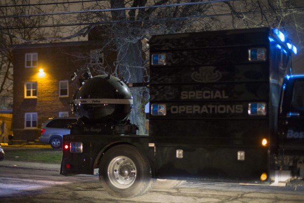 A law enforcement vehicle carries a bomb disposal device through Watertown during a search for the two suspects in the Boston Marathon bombings.
