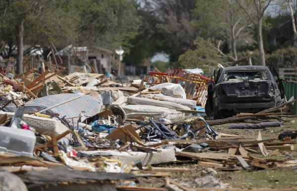 Debris from a destroyed housing complex lies near a damaged vehicle, next to the site of a deadly fertilizer plant explosion in the town of West, Texas on April 21, 2013.