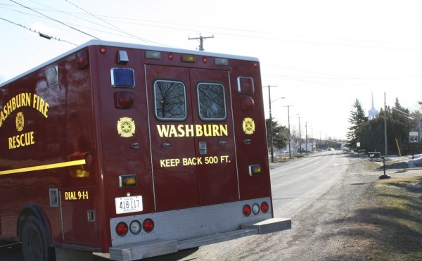 A Washburn Fire and Rescue vehicle assists police in setting up a roadblock Tuesday morning on Route 164 in Crouseville. Police reportedly have been involved since about 1 a.m. with an incident on the road, but have released no details.