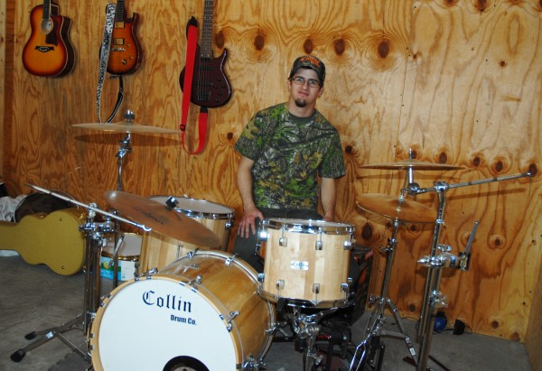 Drummer and drum maker Curtis Collin shows off the first drum kit he hand crafted. Two years and 15 drum kits later, Collin's drums are on tour this summer with Brad Paisley's opening act.