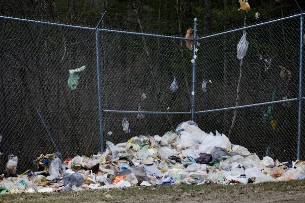 A corner fence at the Bath municipal landfill collects windblown plastic bags. The bags are hard to keep buried at the landfill and also hard to recycle.