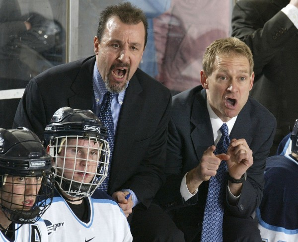University of Maine menb's hockey assistant coach Campbell Blair (left) and head coach Tim Whitehead shout last-minute instructions to the Black Bear players during a defensive zone faceoff in the third period of Saturday night's Hockey East quarterfinal series game at Alfond Arena in Orono. Maine defeated UMass Lowell 4-3 to sweep the best-of-three series.