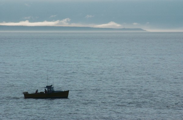 Lobstermen fish off the Cutler coast in September 2006. Grand Manan Island is in the background. Cooke Aquaculture has been fined $490,000 after a pesticide it used killed hundreds of lobsters near Grand Manan Island in 2009, alarming Maine lobstermen.