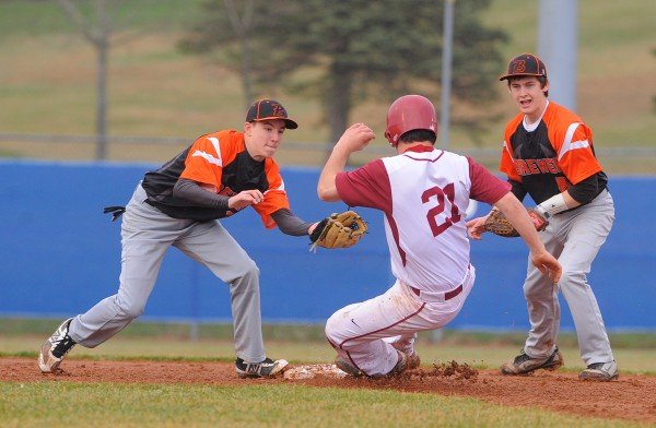 Bangor's Anthony Capuano (center) slides to second base beating the tag by Brewer's Logan Rogerson (left). Brewer's Tony Bissel provides coverage on the play.