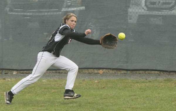 Brewer's Maddy Bailey chases down a ball hit to center frield against Bangor on Wednesday, April 24, 2013.