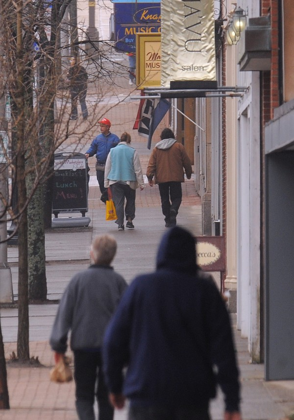 People walk around Downtown Bangor.