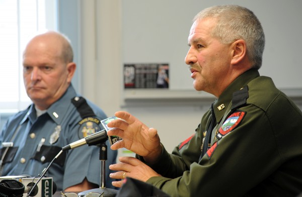 Sgt. Ron Dunham (right) of the Maine Warden Service and Lt. Wesley Hussey of the Maine State Police discuss the dangers of the secretive, illegal party known as Chickenfest during a press conference on Thursday at the Orono Police Department.