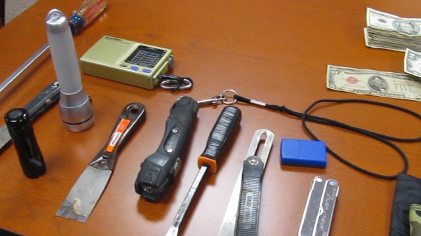 Christopher Knight, who was arrested last week after 27 years of living alone in the Maine wilderness, survived by burglarizing nearby camps and living of what he stole. Shown above are some of the items investigators have recovered from his campsite in Rome.