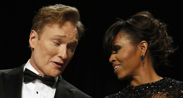 Comedian Conan O'Brien talks to U.S. first lady Michelle Obama during the White House Correspondents' Association Dinner in Washington on Saturday.