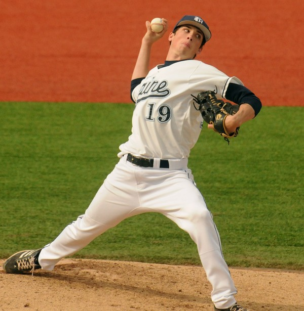 The University of Maine's Burk FitzPatrick pitches during the game against Colby College in Orono Tuesday.