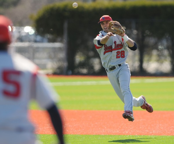 Stony Brook infielder Cole Peragine throws to first for an out against UMaine on Sunday at Orono. Stony Brook won 1-0.