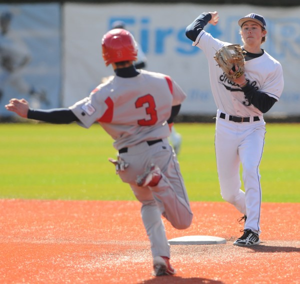 UMaine's Troy Black throws to first after tagging second to get Stony Brook runner Jack Parenty out during 10th inning action at Orono on Sunday. Stony Brook won 1-0.