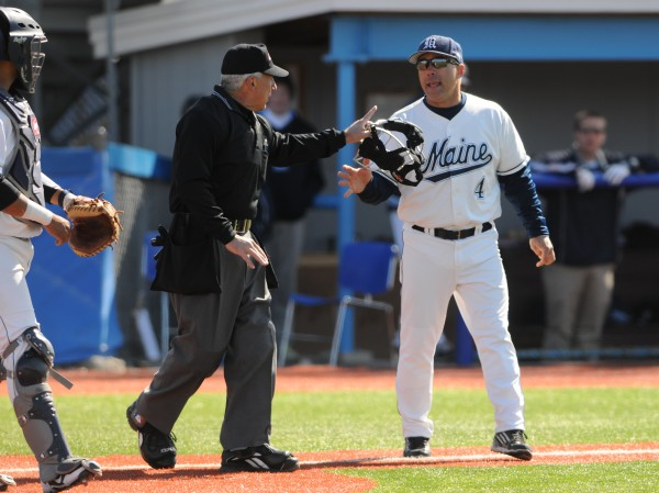 UMaine head coach Steve Trimper argues a call with the head umpire during 10th inning action at Orono against Stony Brook on Sunday. Trimper prevailed in the ruling after much debate.