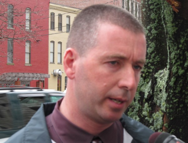 Maine state Trooper Jeremy Forbes fields questions from reporters outside the Cumberland County courthouse Monday morning after convicted rapist Gary Allen Irving signed an extradition waiver clearing the way for his transportation to Massachusetts.