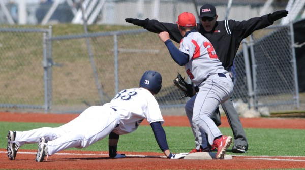 UMaine's Kyle Silva (33) is ruled safe after this pick off attempt at first base. Stony Brook first baseman Kevin Courtney was late with the tag.
