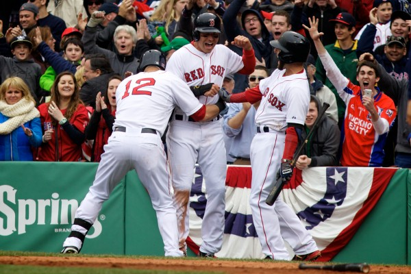 Jacoby Ellsbury (center) celebrates with teammates Dustin Pedroia (right) and Mike Napoli after crossing the plate with the winning run in the bottom of the 10th inning Saturday at Fenway Park.