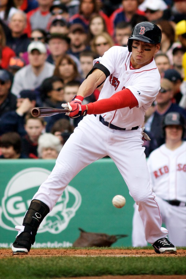 Red Sox center fielder Jacoby Ellsbury hits a foul ball Saturday at Fenway Park in a 2-1 win over Tampa Bay.