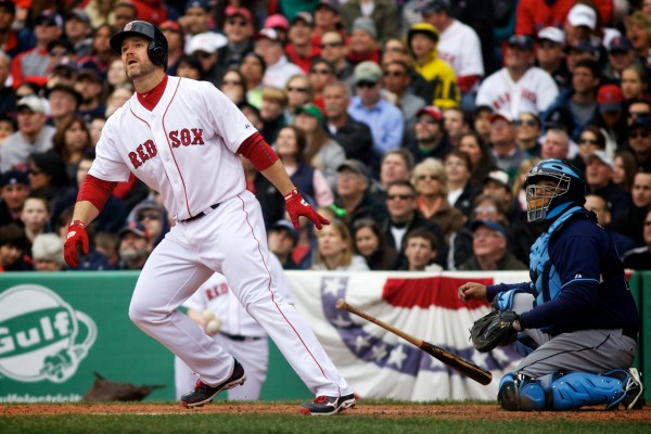 Red Sox catcher David Ross watches after launching a ball over the Green Monster at Fenway Park Saturday.