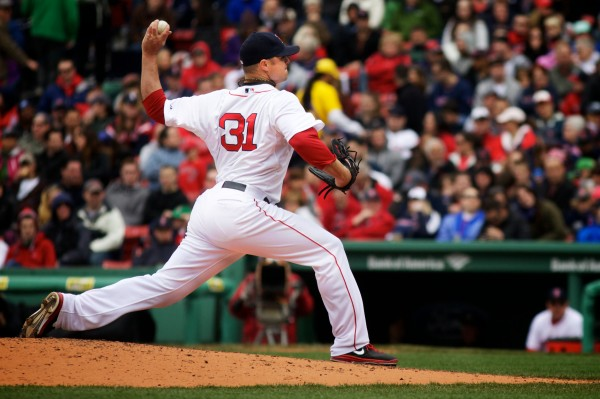 Red Sox starting pitcher Jon Lester hurls a ball Saturday in Boston.