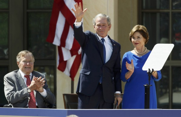 Former President George W. Bush (center) waves between his father, former President George H. W. Bush, and former first lady Laura Bush at the dedication of the George W. Bush Presidential Center on the campus of Southern Methodist University in Dallas, Texas, on Thursday.