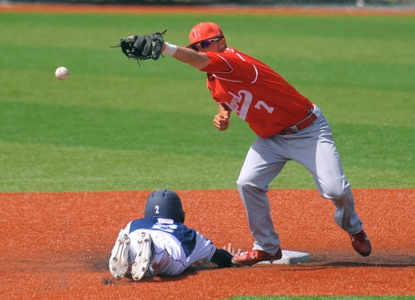 Hartford's Trey Stover (right) can't make the catch as UMaine's Michael Fransoso slides back to second base during the game in Orono on Sunday.