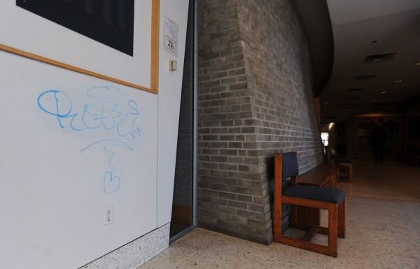 Graffiti can be seen Sunday on the walls of the McNeilly Lobby in the Class of 1944 Hall at the University of Maine campus in Orono.