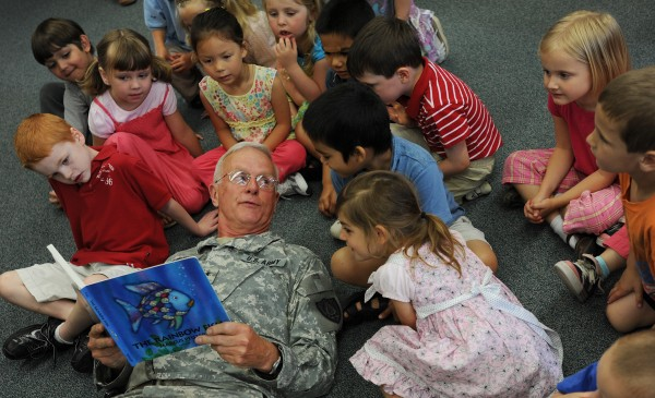 Former Maj. Gen. John W. &quotBill&quot Libby, Maine Adjutant General and commissioner of the Department of Defense, Veterans and Emergency Management, is surrounded by preschoolers Wednesday, June 2, 2010, at 14th Street School in Bangor as he reads &quotThe Rainbow Fish&quot by Marcus Pfister.