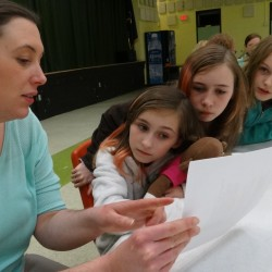 Some Lubec school children learn about a plan to use the empty Lubec High School as a community center.