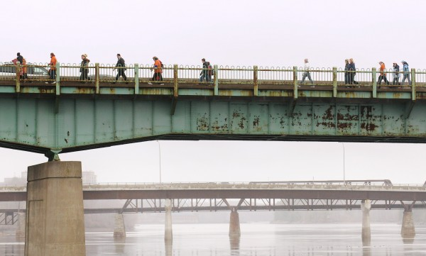 Participants in the 2013 Hike for the Homeless cross the Joshua Chamberlain Bridge as they walk to the Bangor Waterfront Saturday. The 18th annual event is intended to raise awareness and money for the Bangor Area Homeless Shelter. About 770 people from several surrounding communities hiked to the waterfront and raised about $27,000.