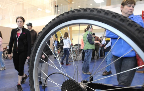 People check out bikes during the 6th annual Great Maine Bike Swap at the University of Maine in Orono Sunday. The goal of the event is to connect people who are looking for affordable used bikes with those who wish to sell them, said Nancy Grant, executive director of the organization.