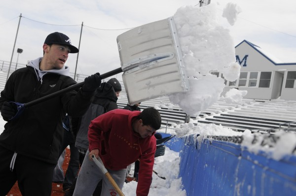 This photo from 2011 shows University of Maine outfielder Kyle Silva (left) and his teammates shoveling snow off Mahaney Diamond in Orono. On Saturday, it was cold rather than snow that forced postponement of the Black Bears' scheduled doubleheader against Binghamton. The teams will play a Sunday twinbill starting at 11 a.m.