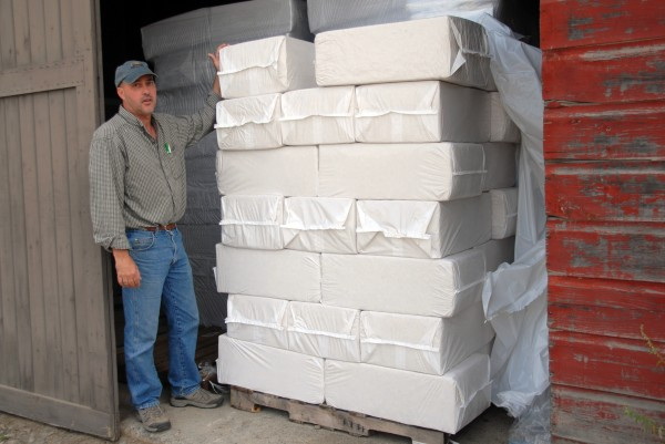 Haskell Lumber Inc. and LMJ Enterprises LLC co-owner Mike McFalls with some packaged inventory at his Lincoln business on Friday, Sept. 28. McFalls has transitioned his Lincoln hardware store from a sawmill to a wood-shavings mill.