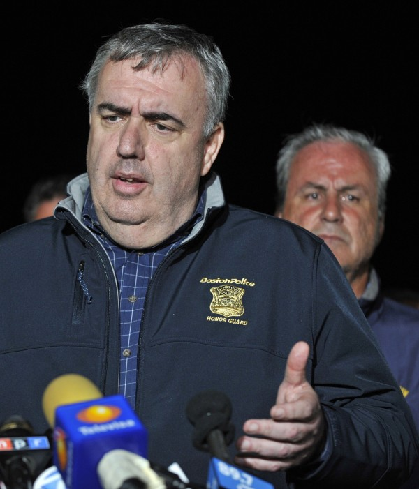 Boston Police Commissioner Edward Davis speaks during a news conference after police apprehended a suspect in the Boston Marathon bombings in Watertown, Mass., on Friday.