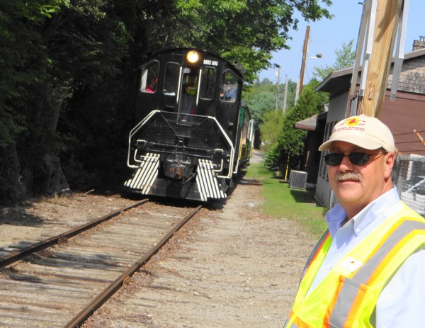 Tom Testa, president of the nonprofit Downeast Scenic Railroad, waits for Saturday's train to return to the boarding area in Ellsworth.