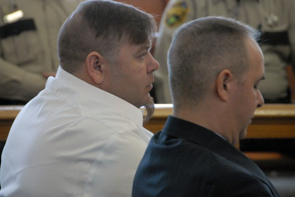 Mars Hill resident Mark Stetson (left) and his attorney, Luke Rossignol of Presque Isle, listen to arguments made during Stetson''s sentencing in Aroostook County Superior Court in Houlton on Wednesday, April 3, 2013.