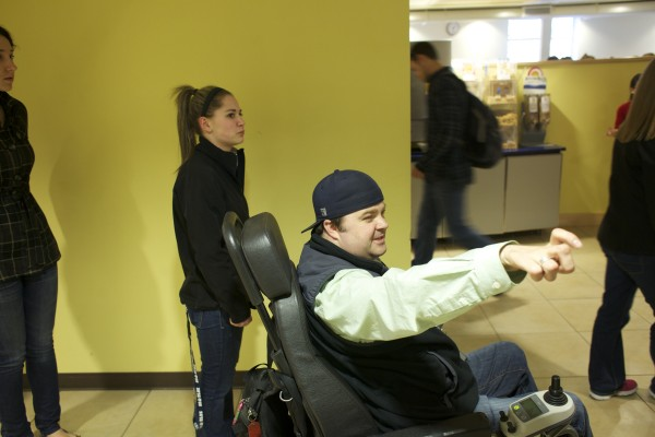 Derek O'Brien (right) waits in line at a University of Maine dining hall with Brianna Johnston. O'Brien will be graduating from UMaine in May 2013 from the school's New Media program.