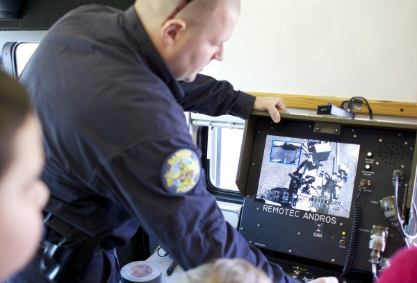 Bangor Police Department Bomb Technician Tim Shaw shows students how to control the police department's bomb robot at the William S. Cohen Middle School in Bangor as part of a demonstration for the school's robotics class Thursday afternoon.