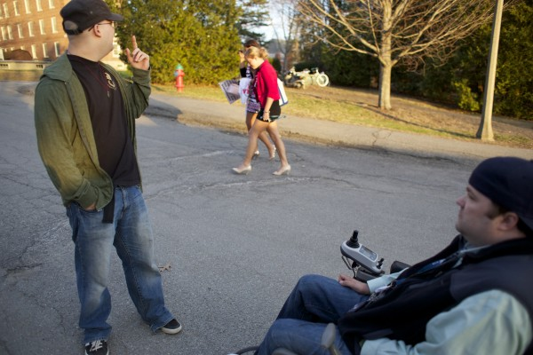 Derek O'Brien (right) talks to his brother Shane at the University of Maine in Orono, near their dorm. O'Brien is a quadriplegic student who will be graduating from UMaine in May 2013.