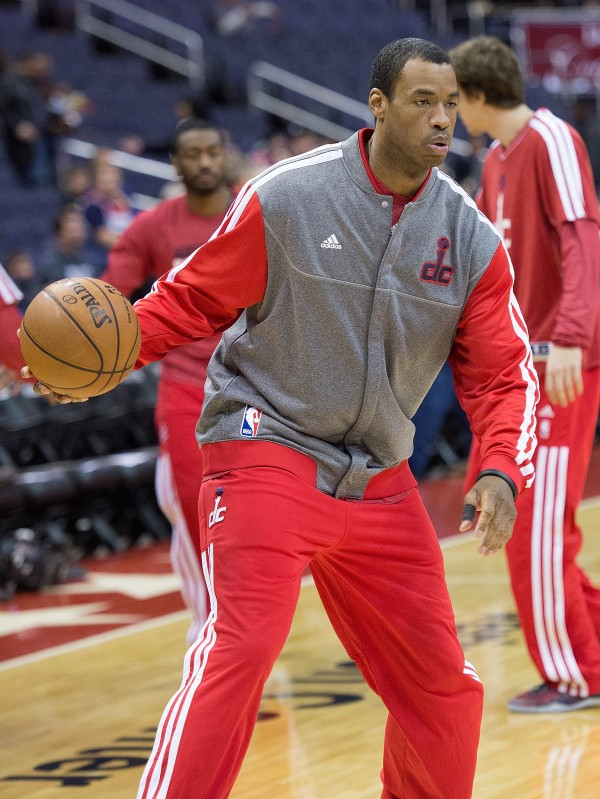 Washington Wizards center Jason Collins warms up before their game against the New Orleans Hornets at the Verizon Center in Washington, D.C., Friday, March 15, 2013.