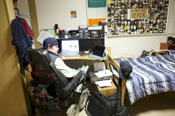 Derek O'Brien works on an assignment for one of his new media classes in his dorm room at the University of Maine in Orono. O'Brien will be graduating from UMaine in May 2013